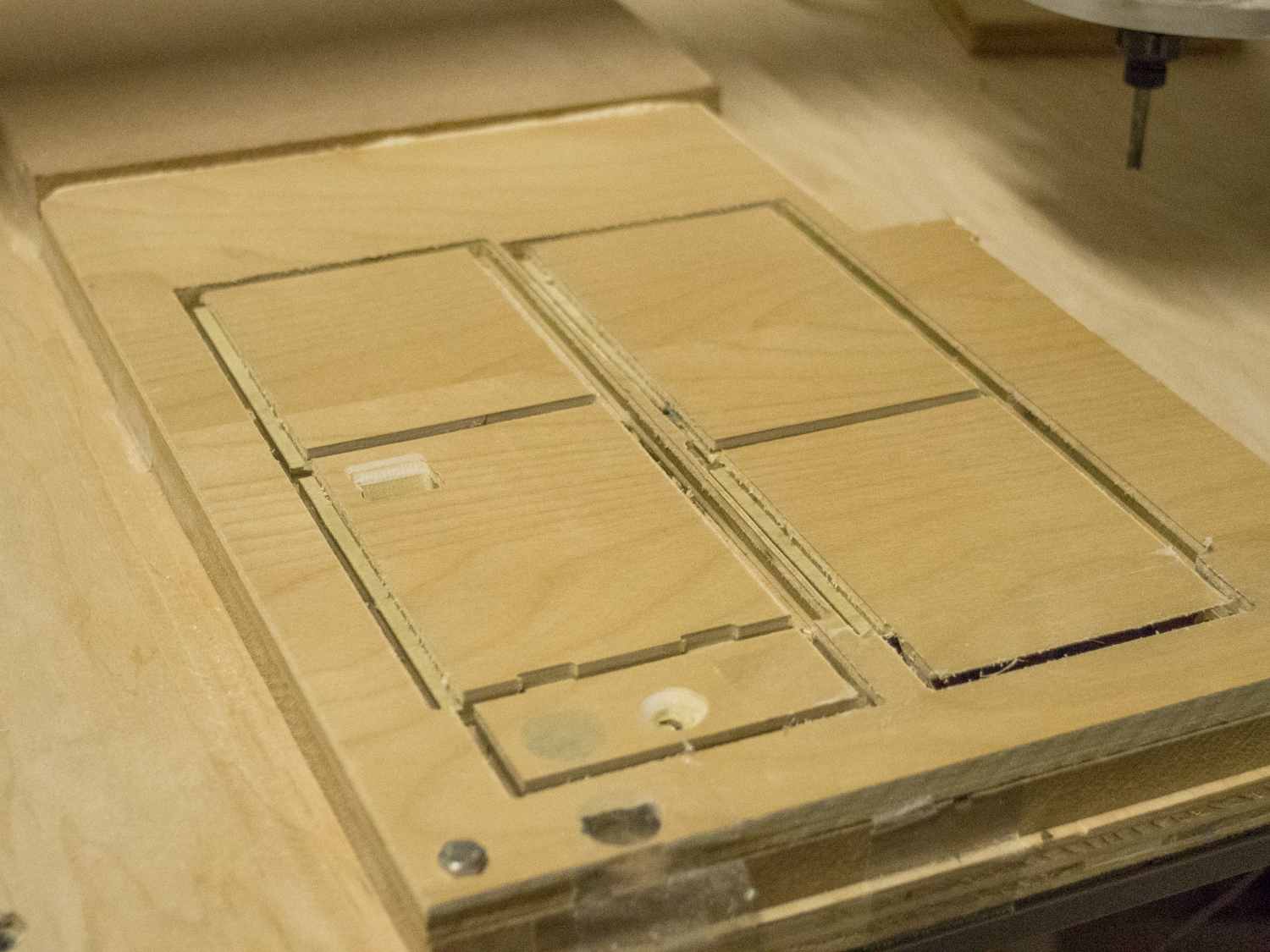 A prototype box was machined out of wood, the final product is white Delrin